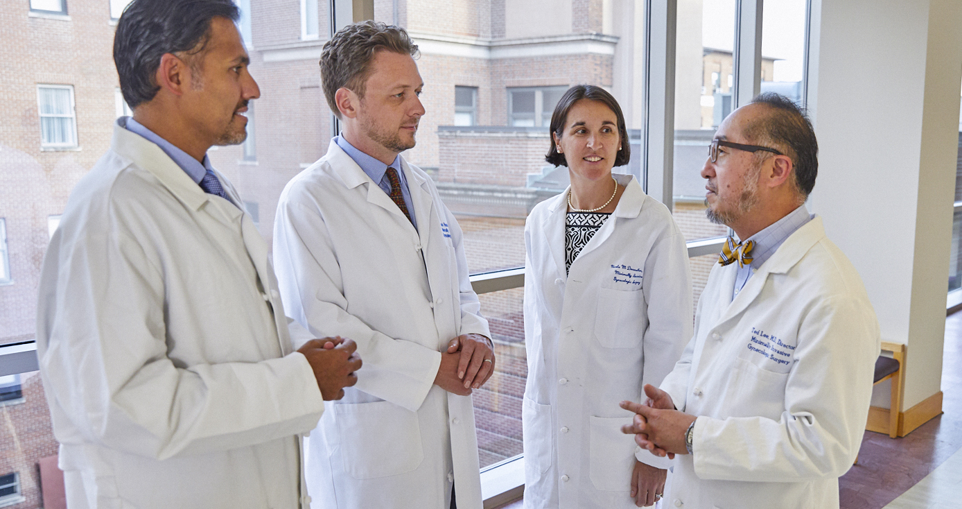 Doctors conversing in white coats