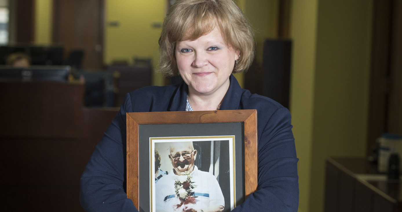 Wanda DiPaolo holds a photograph of her father