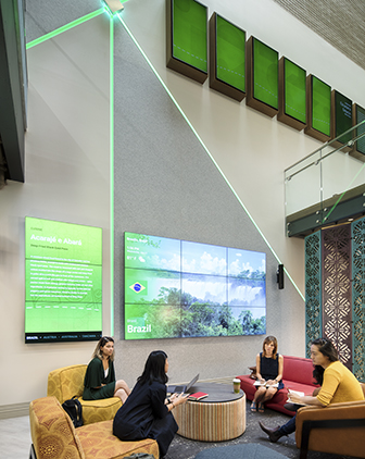 Two-floor image of Global Hub, showing students sitting in the lower floor with a giant Experience Screen showing images of Brazil