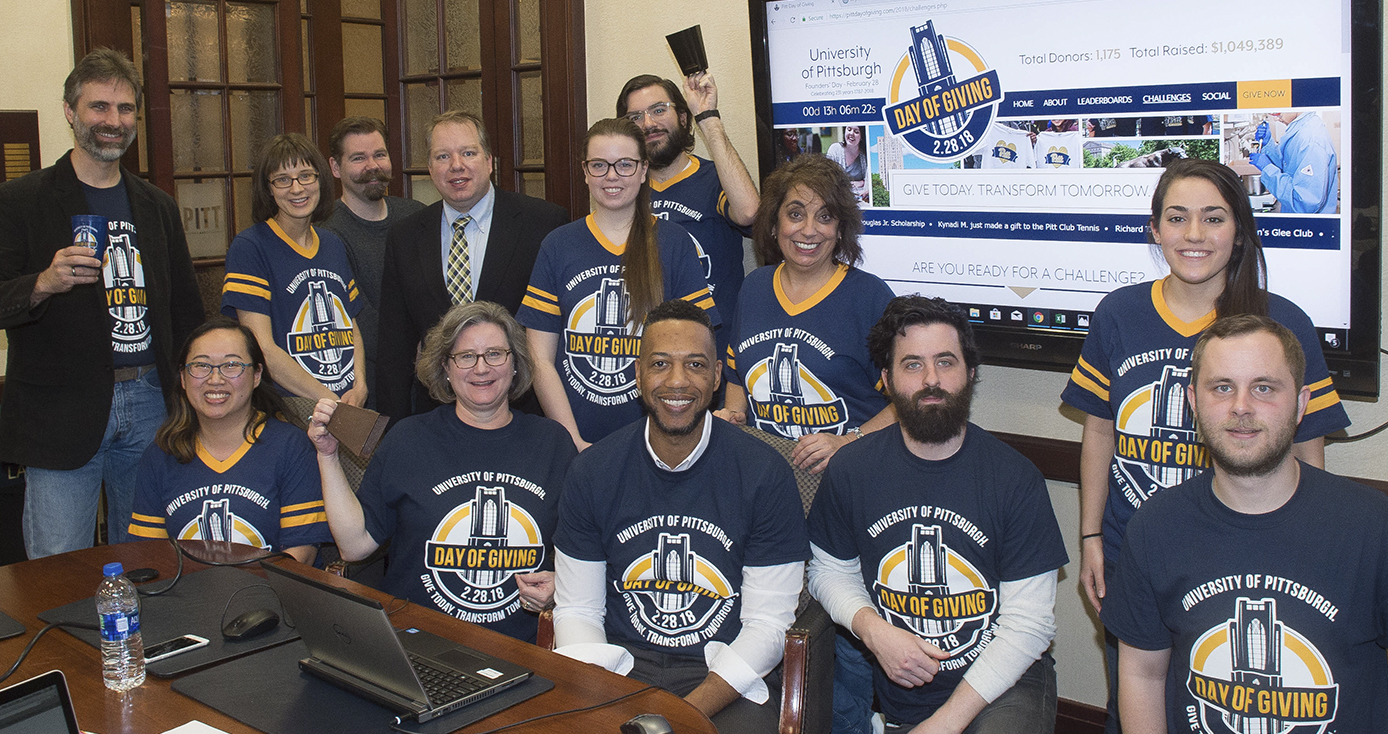 a group of Pitt staffers wearing Day of Giving T-shirts