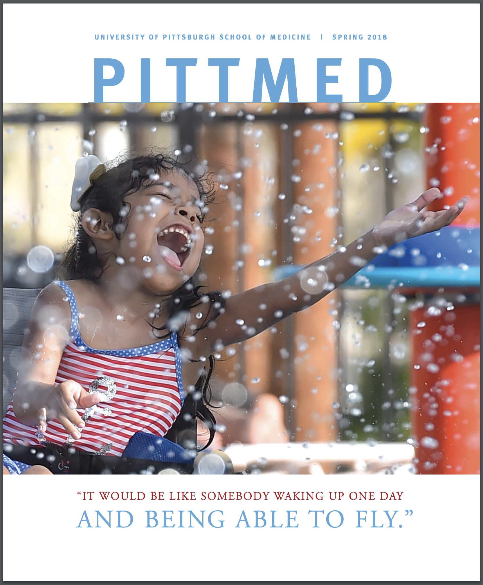 cover of the most recent Pitt Med, which features a little girl in a wheelchair splashing in water