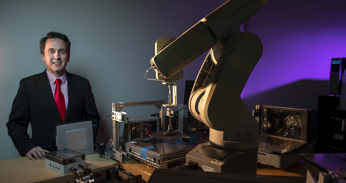 Sejdic standing near a microscope