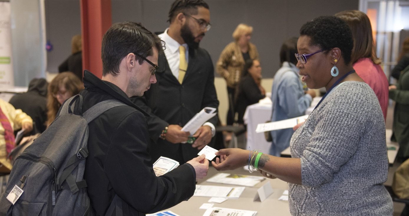 Local entrepreneur Jeremy Burnworth (left) accepts advice from LaMonica Wiggins on his plan for an incubator to help entrepreneurs who have a criminal background. Wiggins was staffing a table at a recent Small Business Resource Fair in Squirrel Hill.