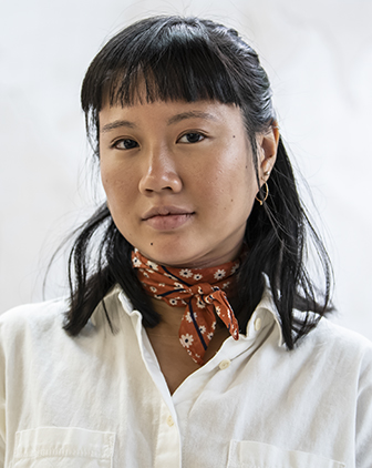 Headshot of Karen Lue, against a white background.