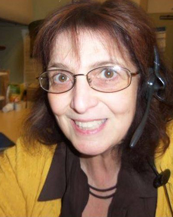 Haberman wearing a headset and yellow blouse
