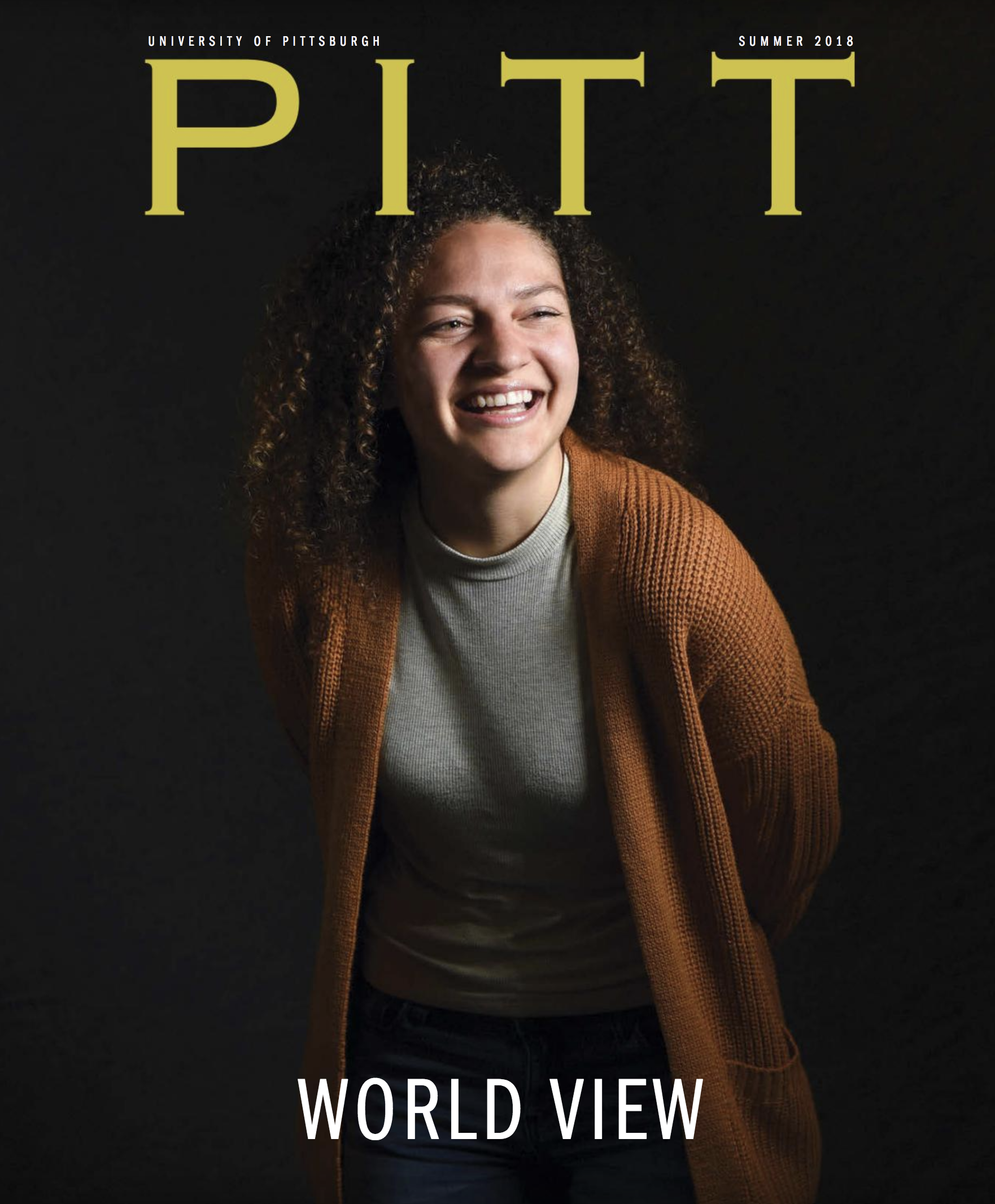cover of the issue, which features a young smiling woman in a rusty colored sweater