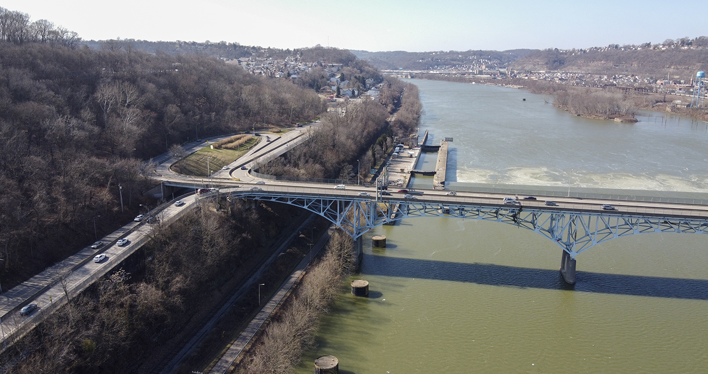 An aerial view of a bridge over a river