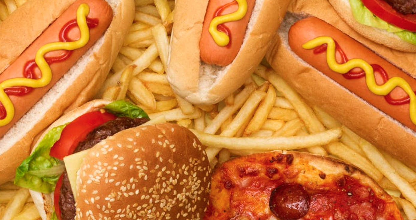 A variety of fast foods, including hamburgers, pizza, hot dogs and French fries