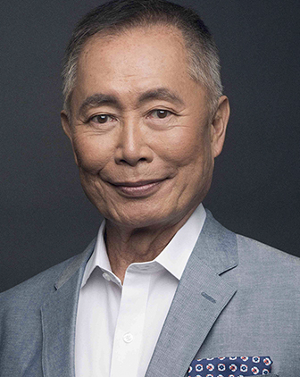 Takei in a gray suit