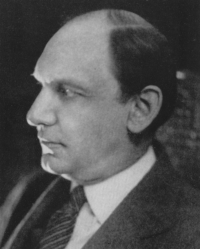 black and white profile image of Klauder in a suit