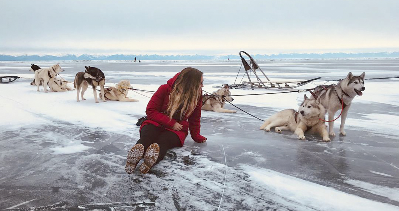 Marjorie Tolsdorf with a group of sled dogs in Russia