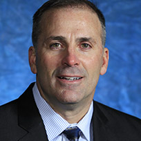 Narduzzi in a black suit jacket