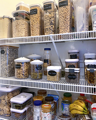 A pantry stocked with containers of whole grains and other ingredients