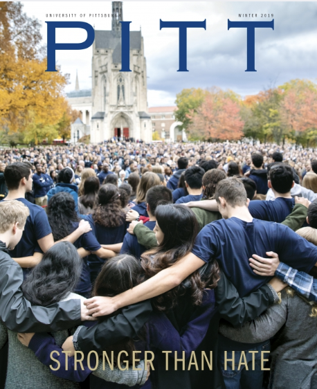 cover of the issue, which features a group of people standing together in front of Heinz chapel
