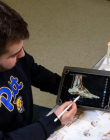 Student using a tablet to interact with a diagram of the anatomy of a foot