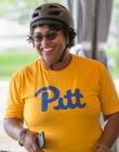 Woman in a Pitt t-shirt with a bike helmet