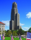 The Cathedral of Learning with flags on the lawn
