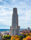 The Cathedral of Learning above colorful tree tops