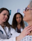 Physician assistant shows technique to student