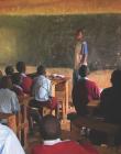 Teacher standing in front of African classroom