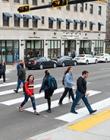 Students walking across a road