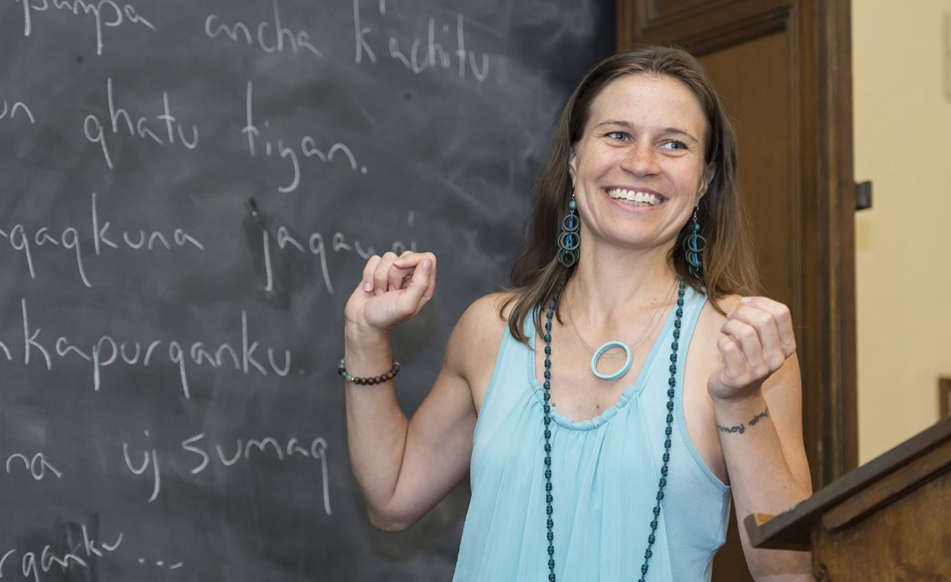 woman in front of a blackboard