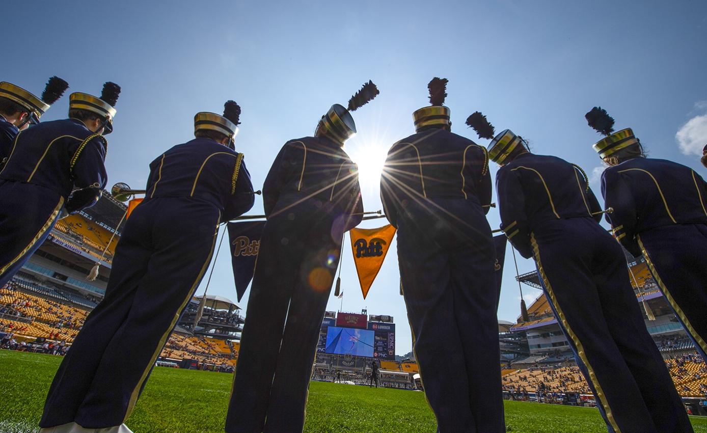 Pitt band members on a football field