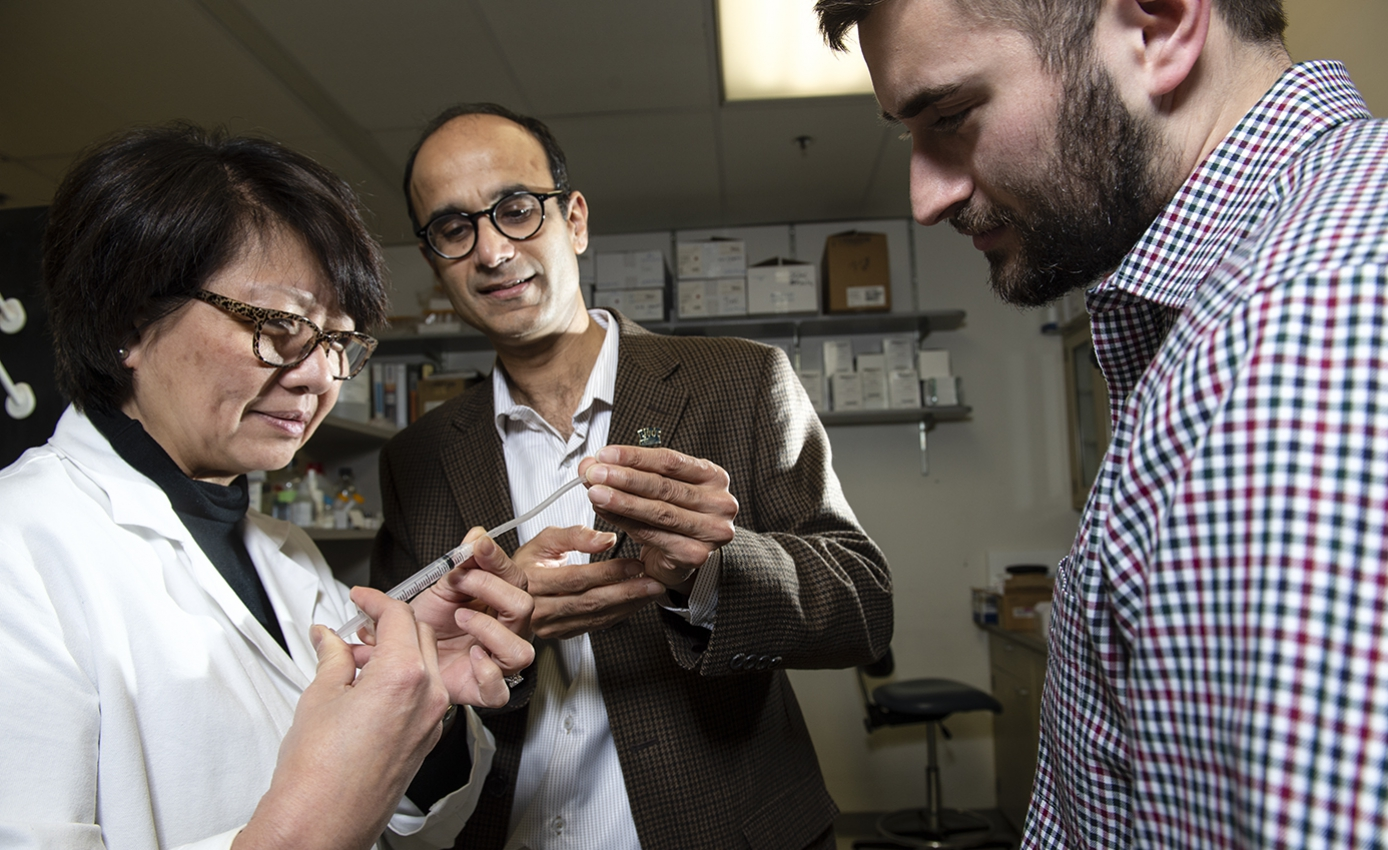 Edith Tzeng, professor of surgery in the School of Medicine; chemical engineering faculty member Sachin Velankar; and Pitt chemical engineering graduate Joe Pugar, with synthetic vascular graft device.