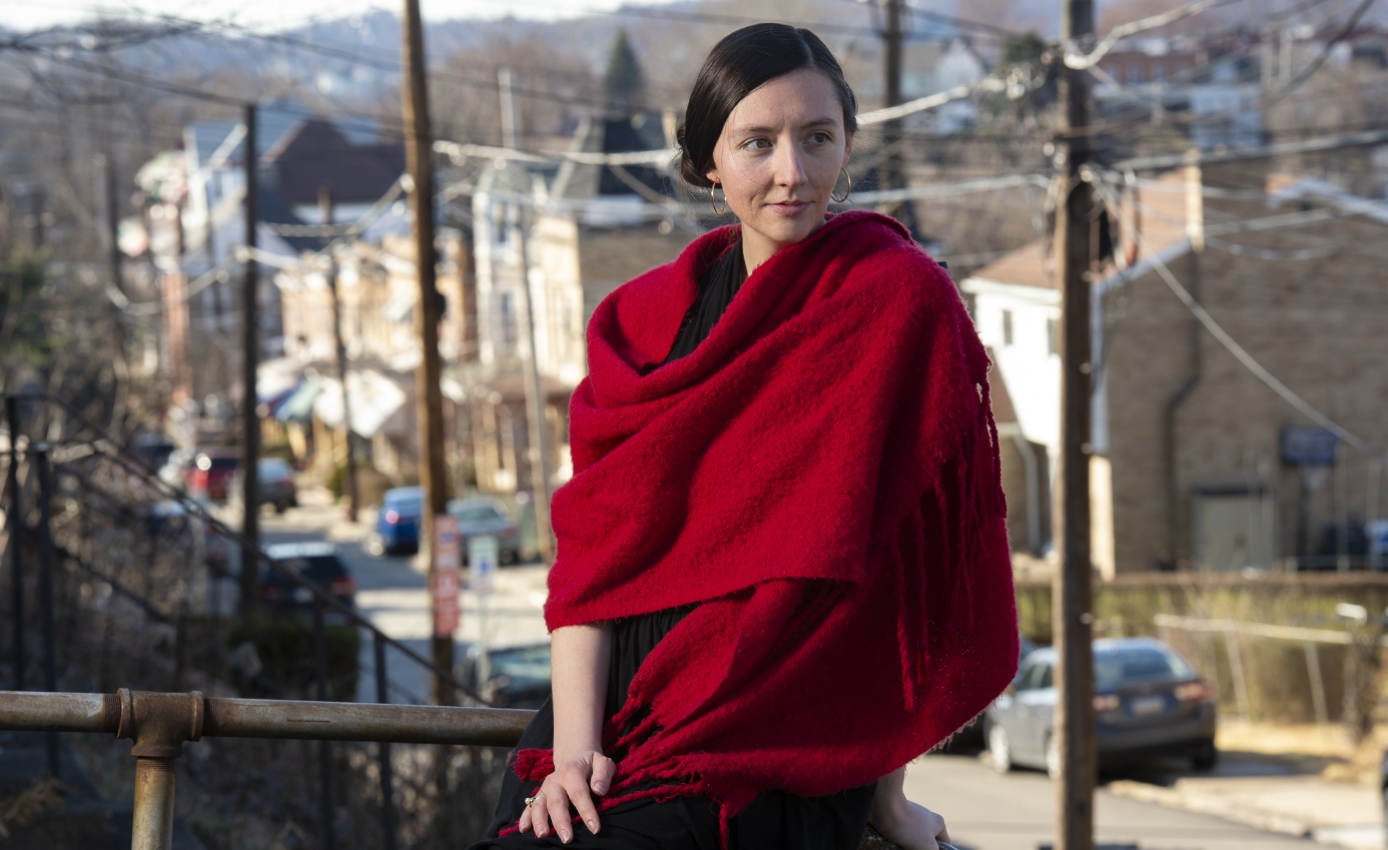 Howell in a red scarf with the city in the background