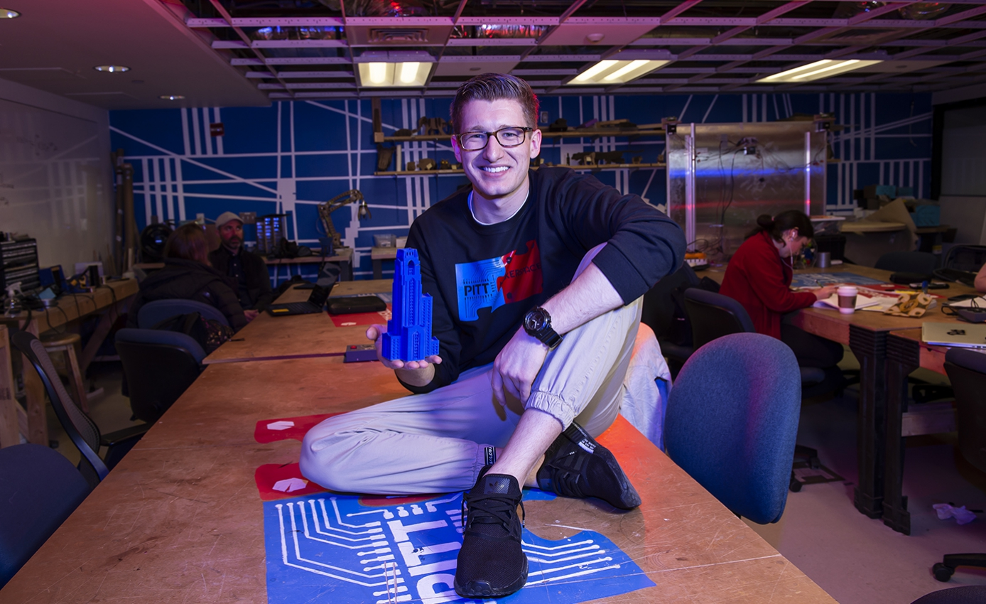 O'Brien on a table in the makerspace