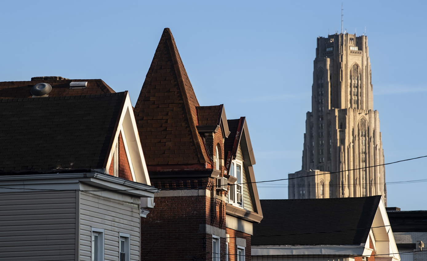 Three Pittsburgh houses with the Cathedral of Learning in the background