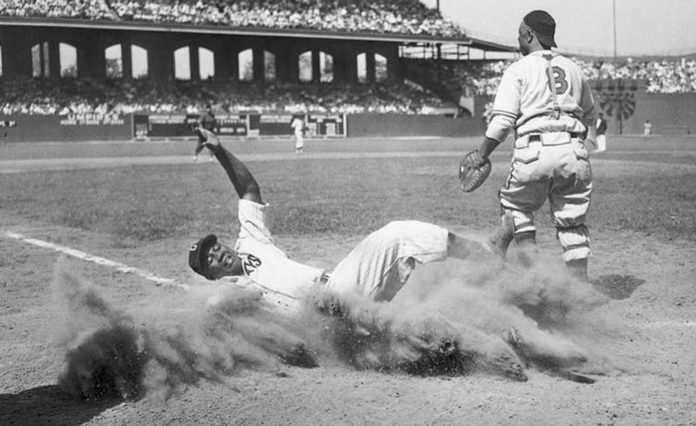 Josh Gibson slides home during the 1944 Negro Leagues All-Star Game.