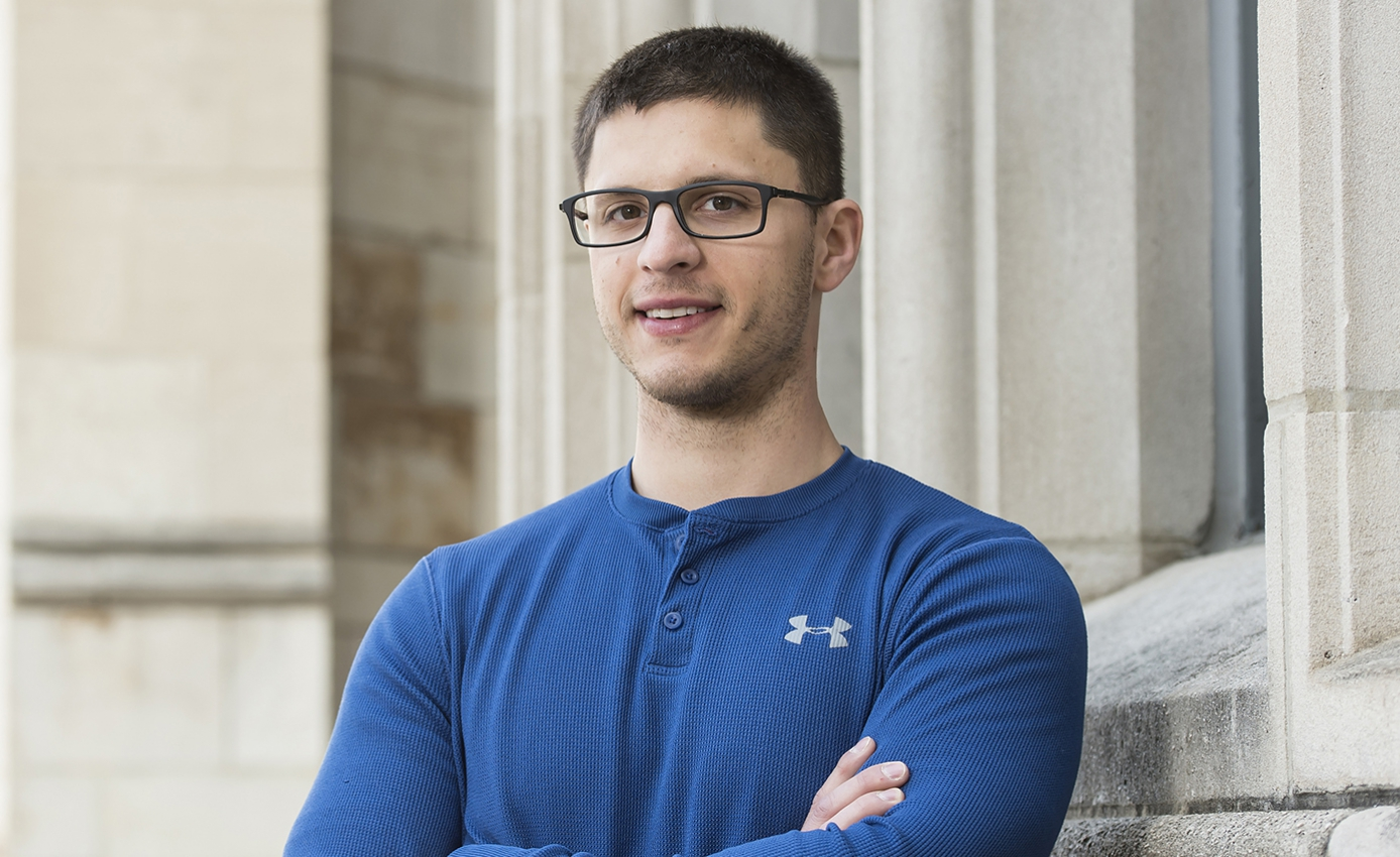 David Matelan in a blue long sleeve t-shirt with arms crossed
