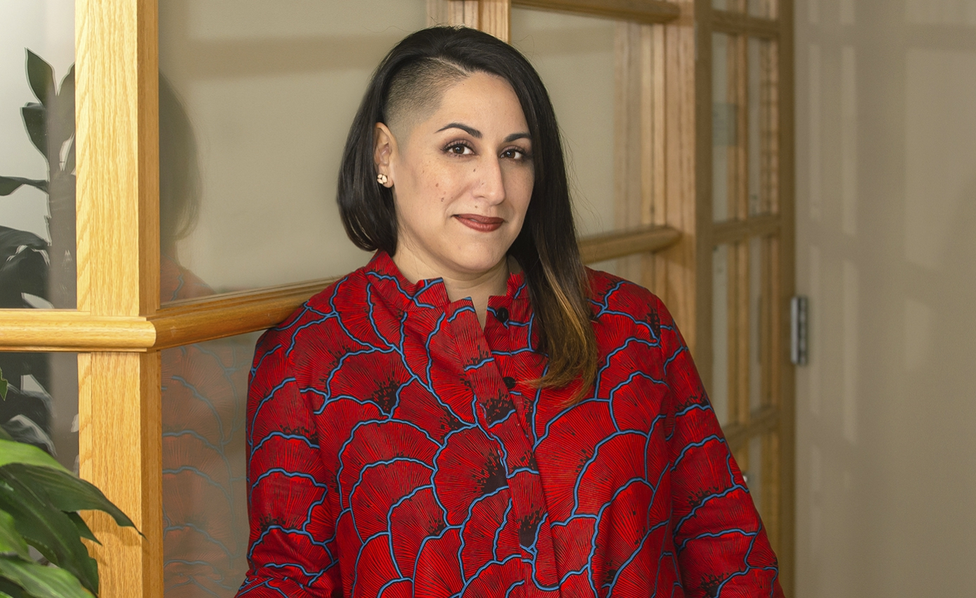 Carla Chugani in a red and blue patterned blouse
