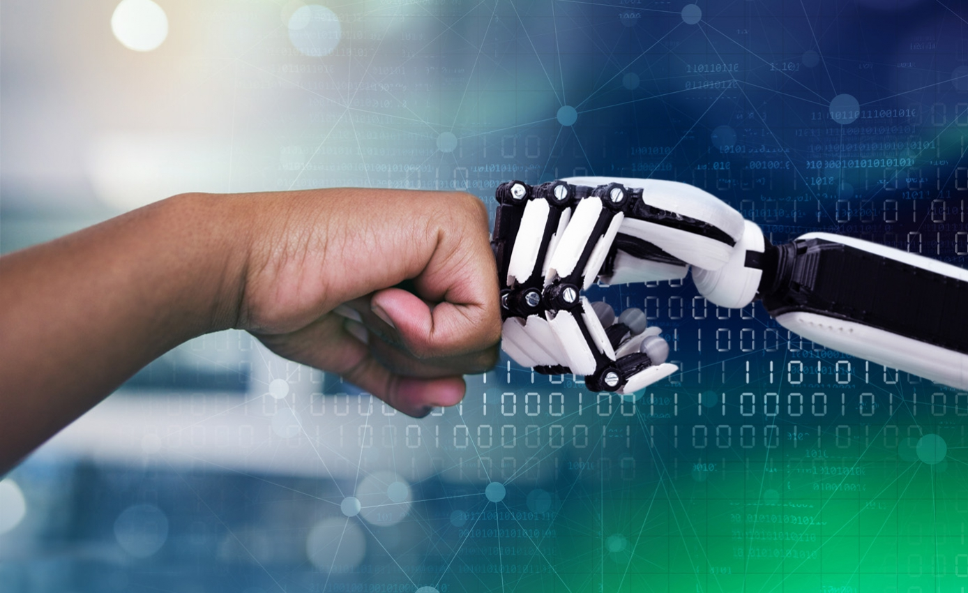 A human and robot fist bumping