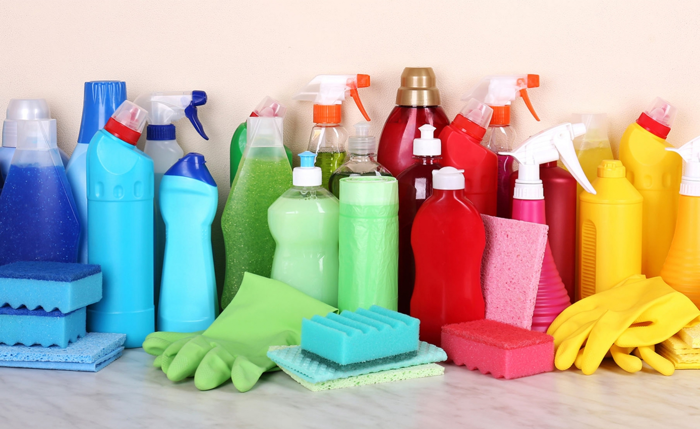 An array of cleaning supplies in rainbow order