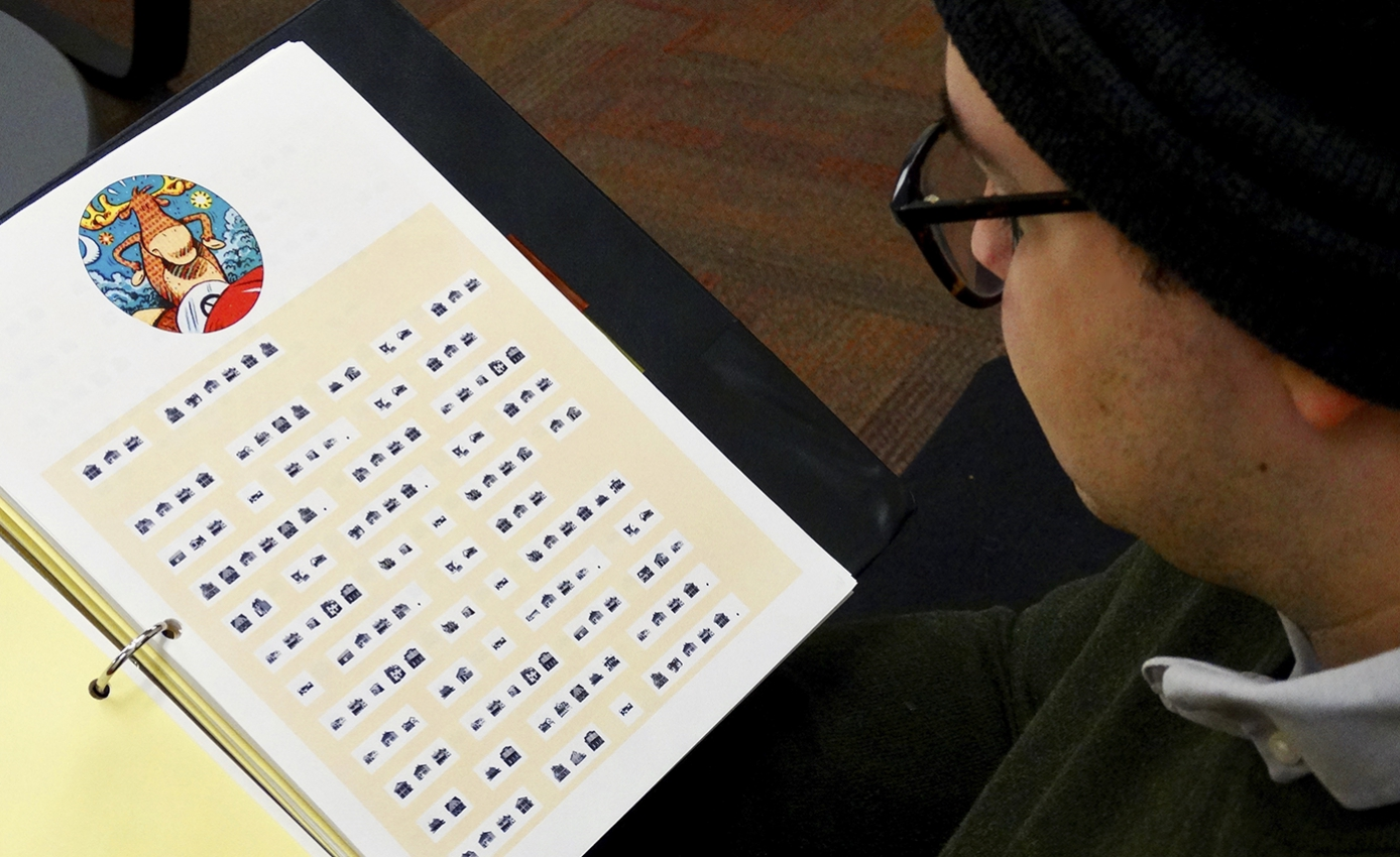a man reading a binder of HouseFont