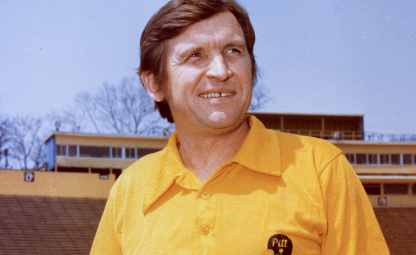 Johnny Majors in a yellow collared shirt