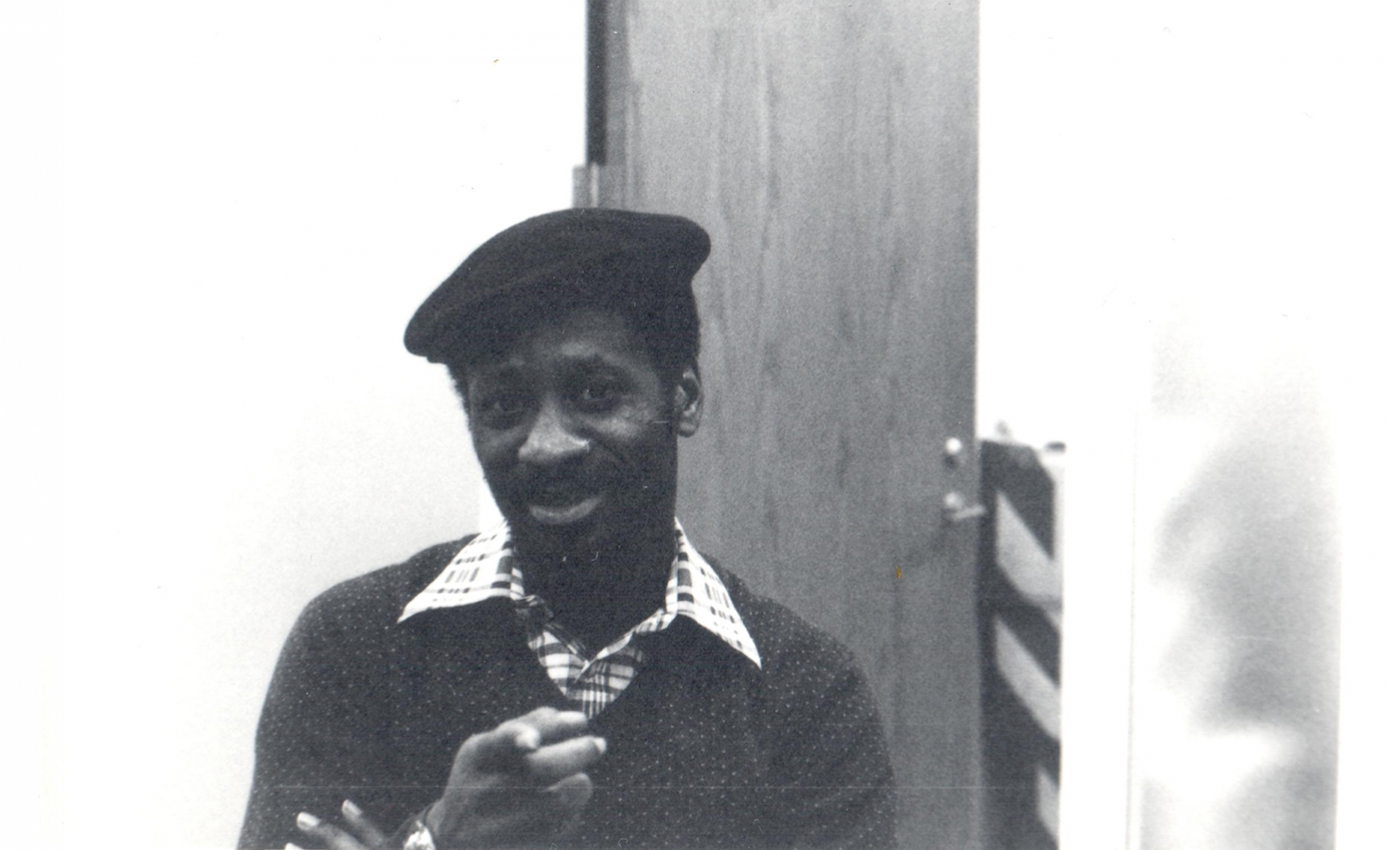 Black and white image of Rob Penny pointing at the camera.