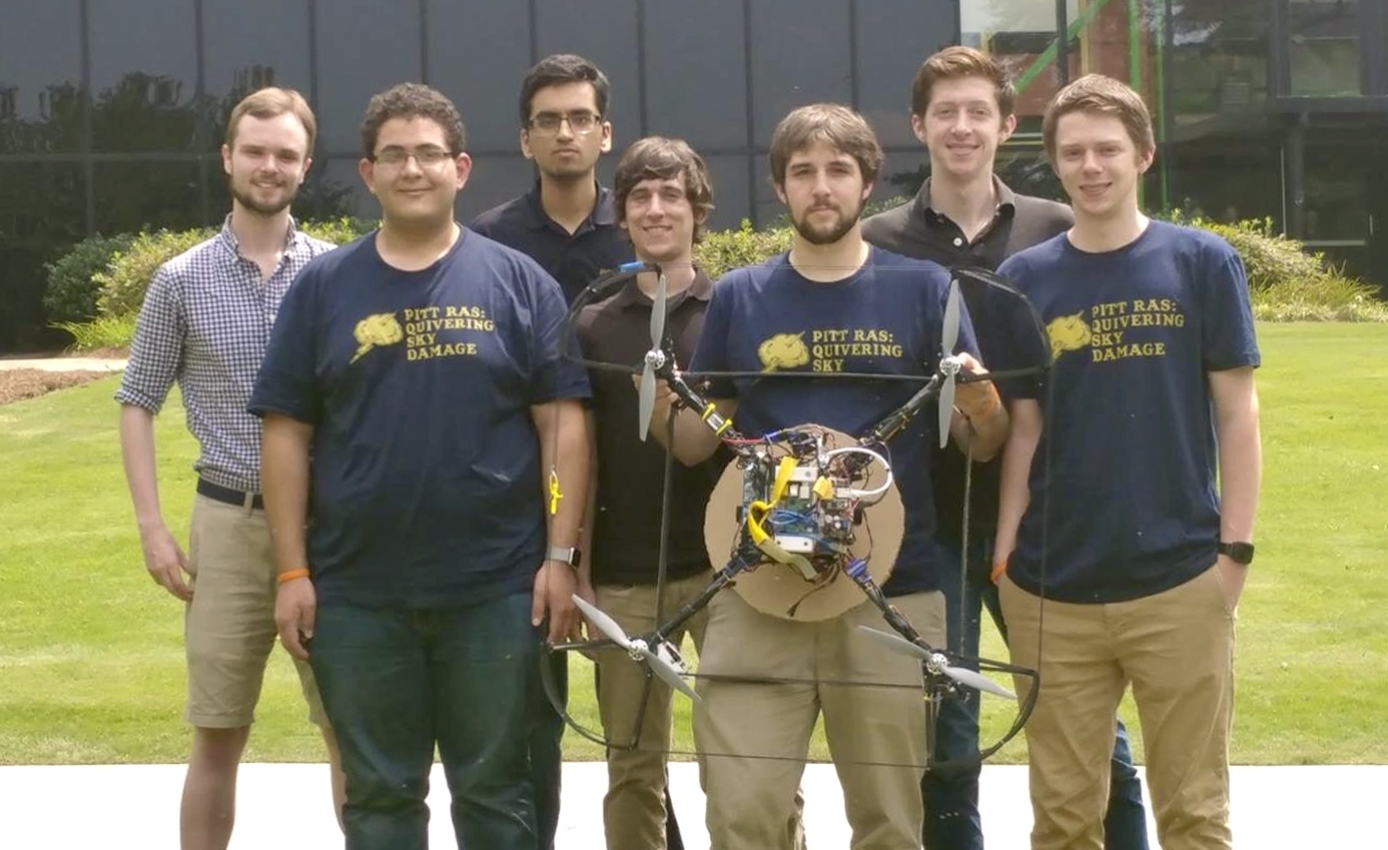 the team, holding the robot