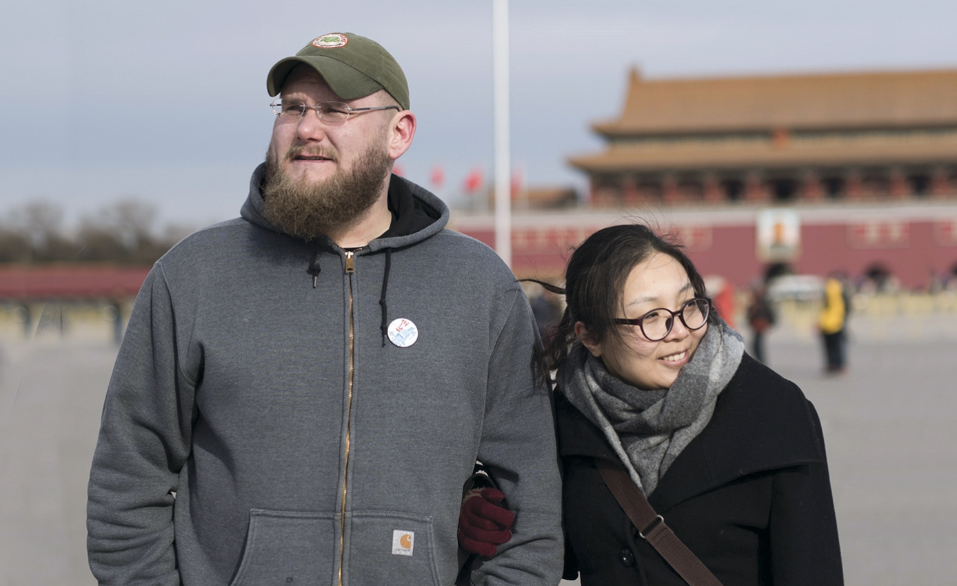Carl Setzer and Liu Fang wearing cool-weather clothing standing outside in China
