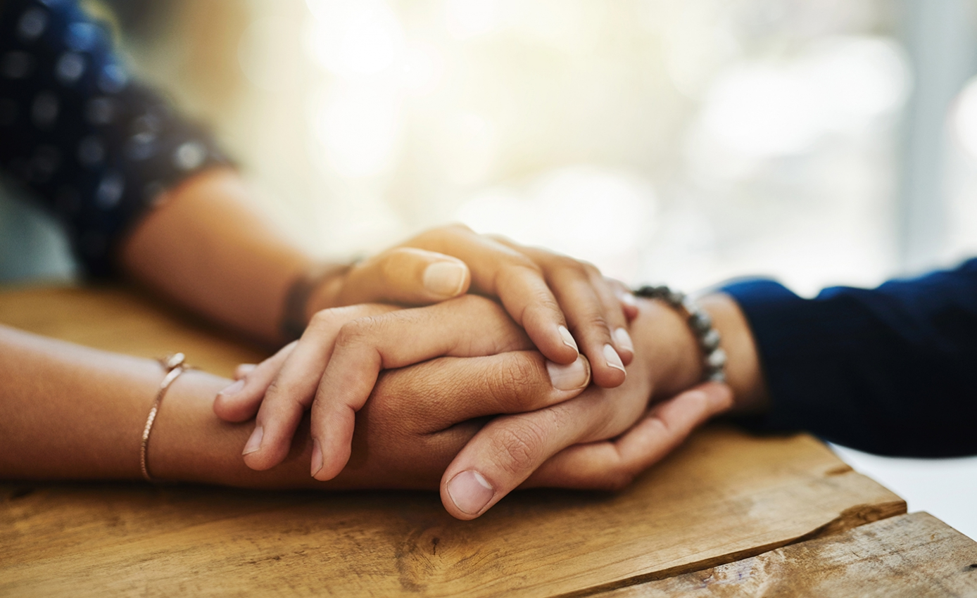 hands held on a table
