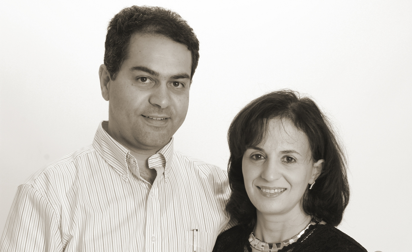 a man and woman standing together smiling