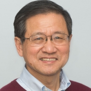 Headshot of Tao Han in sweater and collared shirt
