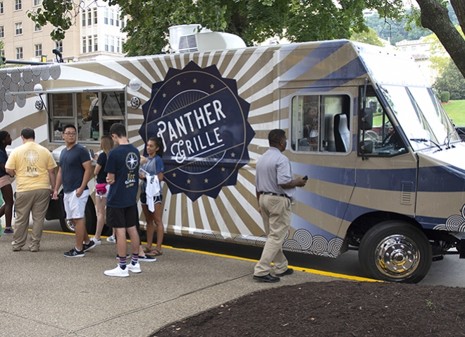 Panther Grille food truck parked on street with several customers waiting for orders