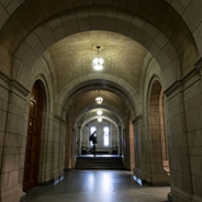 Hallway of the Cathedral of Learning, with a student walking in the background