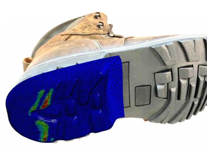 the underside of a work boot—the heel is blue, green and red to show the modeling, while the toe portion is gray and a typical looking tread