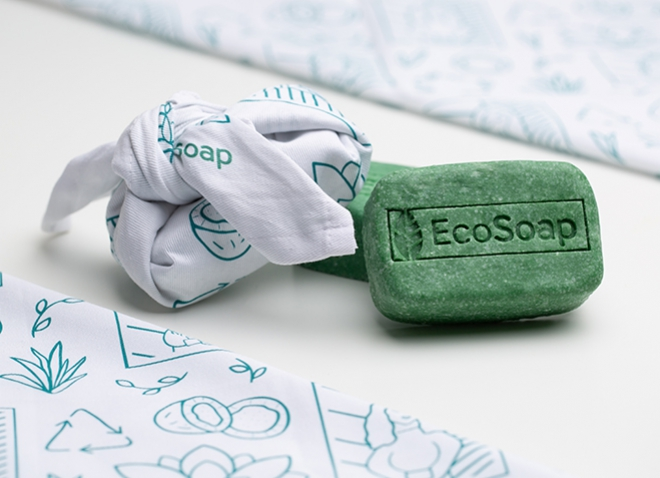a green bar of soap next to a cloth