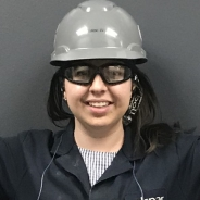 Cailyn Hall in a black jacket, grey hardhat and goggles