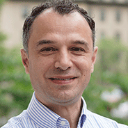 Giuseppe Intini in a light striped shirt